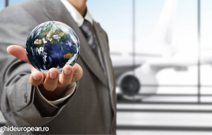 "business man holds globe in the airport""Elements of this image f"