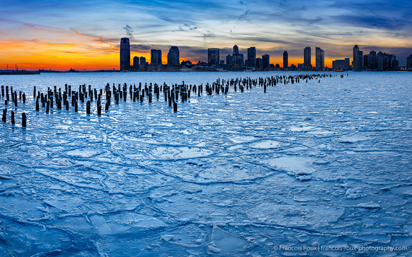 Frozen Hudson River and NYC old pier pilings, looking towards Je